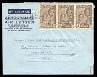 Lot 25618:1964 formular aerogramme to India with 10c Tiger strip of 3, punch-hole at U/L.
