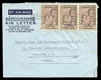 Lot 22490:1964 formular aerogramme to India with 10c Tiger strip of 3, punch-hole at U/L.