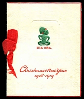 Lot 4444 [1 of 2]:1918-19 Christmas & New Year Card green & red Tiki on face with photo of troops camping in a forest. Fine condition.