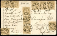 Lot 4139 [1 of 2]:1908 PPC of Odda-Hardanger' (village & lake) franked with ten 1ö brown (incl strip of 3 & a pair) and all tied by strikes of 'BERGEN' cds to GB. Rare multiple use of 1ö. Minor edge blemishes.