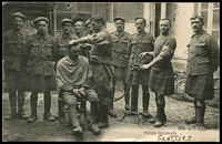 Lot 81:France - Patriotic: black and white card showing Scottish soldiers getting a haircut, has message from Australian soldier in France writing home. The message is dated 20/2/17.