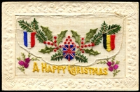 Lot 115:WWI - Silks: WWI pocket silk 'A Happy Christmas' showing flags of France, Britain & Belgium, with short message home from Australian soldier in France.