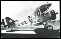 Lot 252:Aircraft: Black & white PPC 'Curtiss 16c-4' bi-plane, real-photo.