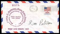 Lot 29293 [1 of 2]:1976 George C Marshall Space Flight Centre Space shuttle engine test cover with cachets signed by Astronaut Don Peterson.