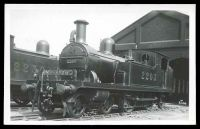 Lot 591 [1 of 2]:Trains: Black & white PPC with Steam Engine leaving Engine shed.
