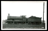 Lot 80:Railways black & white PPC of Steam engine and tender in siding, real photo.