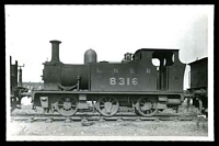 Lot 114:Railways: black & white PPC of Steam engine in siding, real photo.