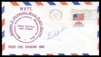 Lot 4541:1977 Space Shuttle Engine Test cover signed by Astronaut Dick Gordon.