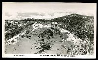 Lot 2852:Mount Buffalo Chalet: - black & white PPC 'The Panorama from Mt Dunn, Mt Buffalo, Victoria', real photo.  Renamed from Mount Buffalo RO 22/8/1910; PO 1/2/1914; closed 24/6/1986.