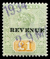 Lot 10598:1900 Postal Fiscals Overprinted 'REVENUE' SG #F39 £1 green and yellow, fiscally used in 1934.