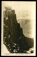 Lot 16572:Mount Buffalo Chalet: - Black & white PPC 'Wall of the Gorge, Mt Buffalo, Vic', real photo, unused.  Renamed from Mount Buffalo RO 22/8/1910; PO 1/2/1914; closed 24/6/1986.