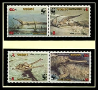 Lot 3333 [1 of 3]:1990 Gharial SG #340-3 MUH set on WWF pages giving details of this threaten species comes together with set on WWF illustrated FDCs, unaddressed nice lot.