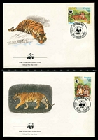 Lot 25181 [2 of 3]:1984 Tiger SG #704-7 MUH set on WWF pages giving details of this threaten species comes together with set on WWF illustrated FDCs, unaddressed nice lot.