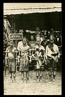 Lot 99:New Guinea: Black & white PPC with scene of natives in local costume, real photo, nice card.