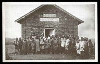 Lot 464:Congo: Real Photo Issues in connection with the Congo Jubilee Exhibition, of the Baptist Missionary Society, 1928, view showing Native children & adults outside of the Sudbury Dispensary building.