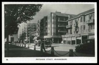 Lot 77:South Africa: Beanes Photo Service Real Photo 'Pritchard Street, Johannesburg', Empire Exhibition, Johannesburg, South Africa 1936, veiw of park and street buildings.