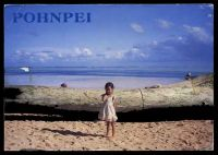 Lot 571 [2 of 2]:Micronesia: Dick Merritt Productions colour PPC of girl on beach with driftwood, franked with 10c soldierfish block of 4 & 5c brown men's house block of 4, cancelled with poor double-circle of OCT 18 1990, addressed to Australia.