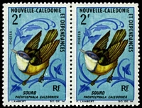 Lot 4398 [1 of 2]:1966-70 Birds SG #405 2f Pachycephala caledonica pair, with Small white flaw behind birds right foot, tiny crease at base.