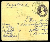 Lot 23333 [1 of 2]:1943 use of 1½a purple KGVI envelope, cancelled with double-circle 'MYLAPORE/REG/26APR43/3PM/MADRAS' (A1-), uprated with 3a bright violet KGVI, bearing blue & black provisional 'MYLAPORE (MADRAS)' reg label, backstamped with double-circle 'KOTHAMANGALAM/27APR43' (A1), worn edges, slightly reduced at right.