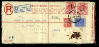 Lot 3534:1920 use of 2d blue KGV & Arms Registered letter envelope, H&G #C11, cancelled with poor cds of 4FE20, uprated with 1d red Seal x2 & 1d red 'WAR TAX' & bearing blue registration label, to Halifax, Nova Scotia, Canada, backstamped with light 'HALIFAX N.S./FE12/20/CANADA' (C1), o/o for viewing, heavy vertical crease & generally a bit grubby.