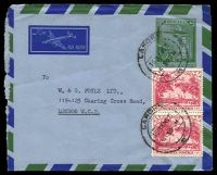 Lot 26893:1957 use of 12a green airmail envelope, uprated with 1a carmine-pink pair, cancelled with double-circle 'LAHORE/15JAN57/430 M/?' (B1), to London, o/o for display, with rough left edge.
