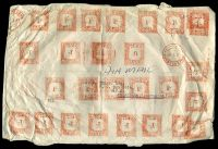 Lot 4450 [1 of 2]:1947 use of 27 strikes of 1/- meter in red with 1 strike of 6d meter in red, cancelled with 'JOHANNESBURG/3V47' (A1) in red, on large cover to Melbourne, Vic, by air, extensive creasing due to thick contents. [Extraordinary rate of £1/7/6d - 10½-11oz rate (22 times the base rate of 1/3d).]