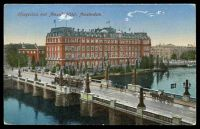 Lot 537 [1 of 2]:Netherlands: coloured PPC of 'Koogesluis met Amstel-Hôtel, Amsterdam', 7½c brown & 5c red Wilhelmina, cancelled with double-circle 'AMSTERDAM/11-12v/20·1/1922/***' (A1-) machine, to Canterbury, Vic, some toning on reverse.