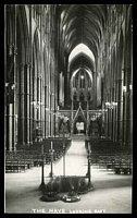 Lot 90:Great Britain: black & white real photo PPC of Westminster Abbey 'THE NAVE LOOKING EAST'.