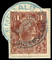 Lot 1214:Emerald: 26½mm 'EMERALD/??AU20/QUEENSLAND' in blue on 1½d brown KGV (cut-to-shape). [Rated 3R]  PO 5/6/1879.