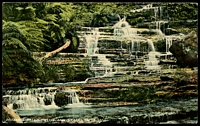 Lot 345:Australia - New South Wales: multicoloured PPC 'Britannia Falls, Blue Mountains' G. Giovanardi, Sydney card, unused.