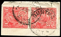 Lot 4634:Duntroon (1): 2 partly overlapping strikes of recut 'DUNTROON/3SP25/F.C.T.' ('AUSTRALIA' removed and re-engraved with 'F.C.T'!) on 1½d red KGV perf 'OS' vertical pair.  PO 1/9/1917; closed 31/12/1930.