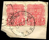 Lot 1403:Ramornie Works: - 'RAMORNIE WORKS/23FE1911/N.S.W.' on 1d Arms pair on piece.  Renamed from Ramornie PO 1/8/1906; TO 25/2/1927; closed 30/6/1955.