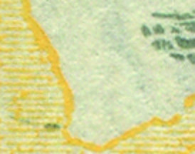 Coloured flaws to far bottom left of edge of grass at left